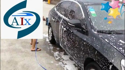 A man is cleaning a car by a self service car wash, http://www.washcarmachine.com/