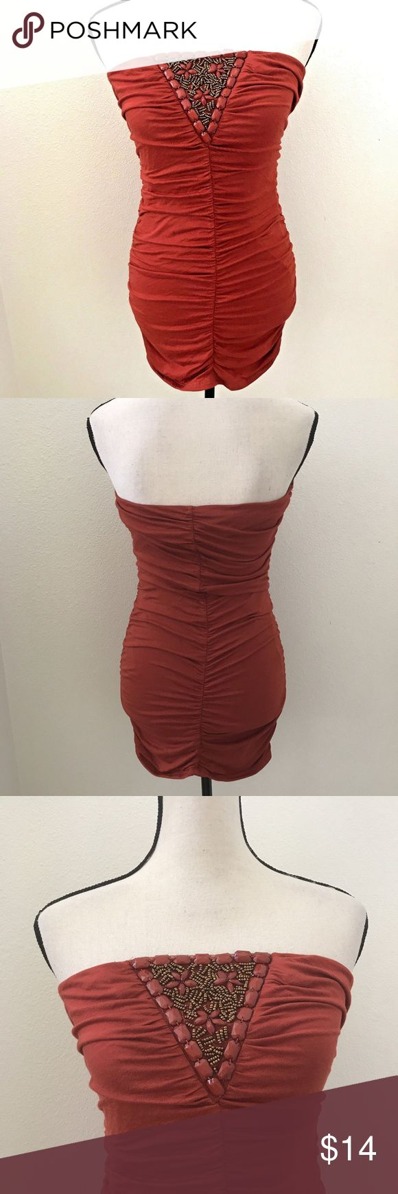 "Rustic Orange Tube Dress Strapless Bodycon size L rustic orange mini dress bodycon strapless beaded clubwear.  95% rayon 5% spandex.  COLOR: Rustic Orange  SIZE: L Juniors  CONDITION: Pre-owned in excellent condition with no signs of wear, holes, rips.  MEASUREMENTS: (Laying Flat) Length- 25""  Armpit/Chest(across) - 14.5"" Waist(across)- 12 1/4""  HYO A5 Vanilla Bay Dresses Mini"