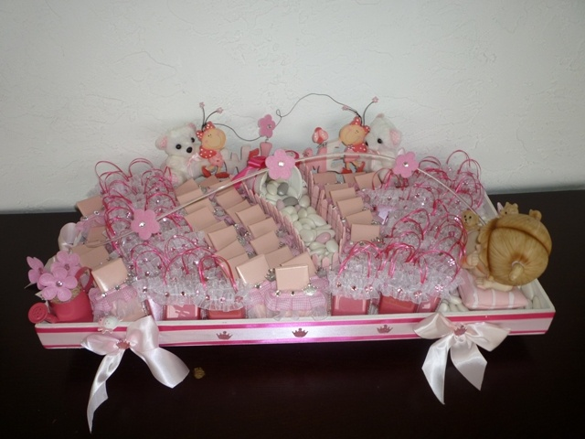 Chocolate Favors  Arrangement for Baby Shower. 75 pieces of Milk Chocolate favors were created to welcome baby Grace. This arrangement was shipped to New Jersey.  Congratulation to the new parents.