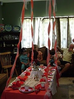 Table set up with a tea partyPoppins Birthday