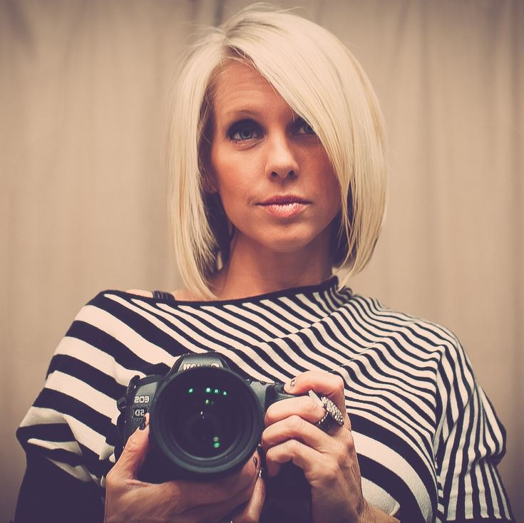 LOVE this cut and color & the fact she's holding a camera, kind of love her top too!