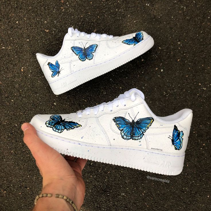 Custom painted Air Force Ones with blue butterflies around
