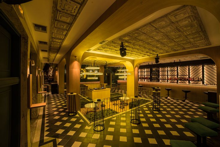 Interior architecture design of Venice bar. Gold plated lights, black and white tiles, amazing ceiling, herringbone bar. www.circusdesignstudio.com