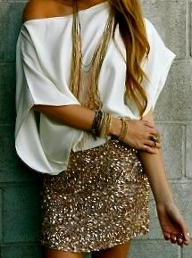Way to wear a sequin mini skirt: with a big sleeves white shirt on it.