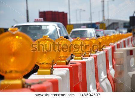 http://thumb10.shutterstock.com/display_pic_with_logo/347509/146594597/stock-photo-orange-construction-light-on-barricade-146594597.jpg
