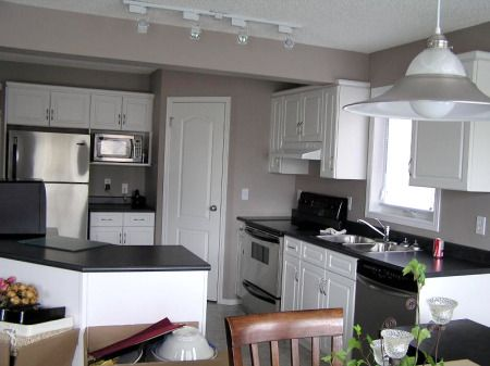 Before color grey walls black countertop white cabinets White cabinets grey walls