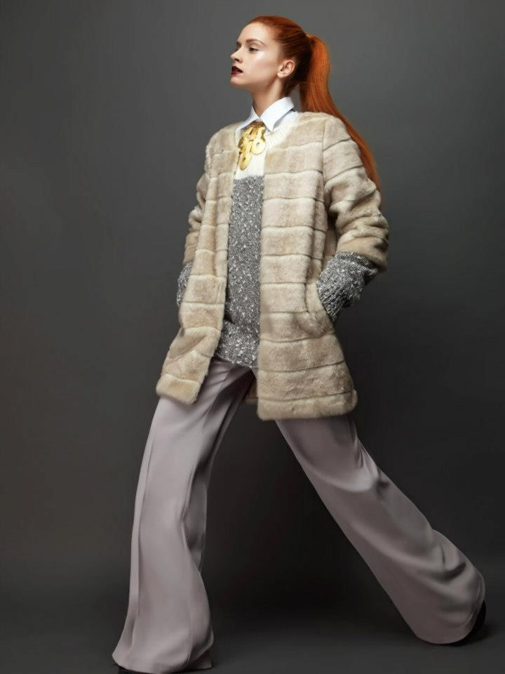 Stylish fur coat and high waist trouser.