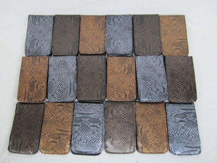 New order of Sunfish snake skin leather scorecard and yardage book holders. www.sunfishsales.com