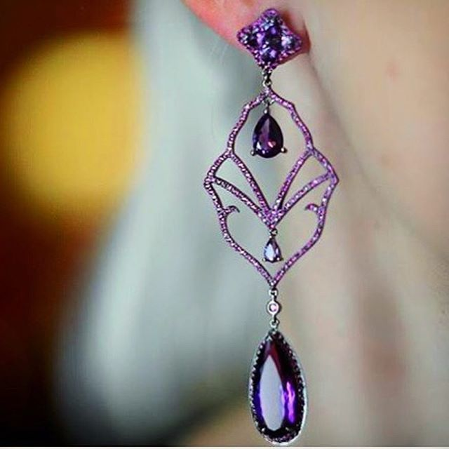 Possibly one of the most perfectly balanced and intriguing piece of #jewelry ever made.  Royal in purple #amethysts and red #rubies.  By the talented and unique @dioneaorcini.  #globalnomad Amethyst and rubies earrings by #dioneaorcinifinejewelry #Amethyst was  considered a symbol of royalty and beauty through the history, and it's also known as the magical gemstone for those born under the signs of #Aquarius and #Pieces.  Repost from @plukka, available at Plukka new store in Burlington…