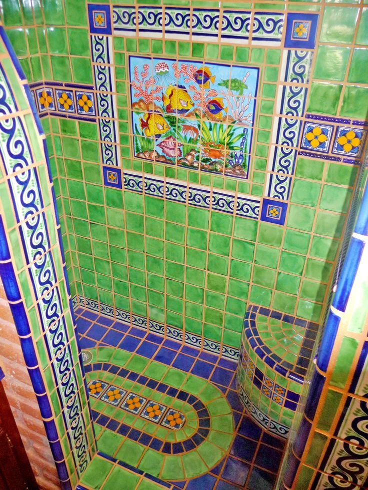 Bathroom shower using Mexican tiles by kristiblackdesigns.com