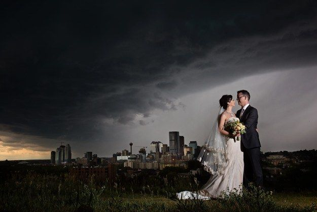 The result is this amazing shot, taken just before the storm drenched the entire wedding party. | A Crazy Calgary Hail Storm Led To The Most Awesome Wedding Photo