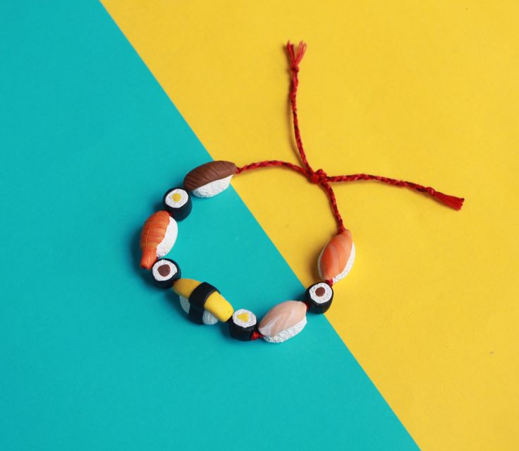 Do you love sushi? So do we!!  The Sushi Time bracelet features 9 handmade polymer clay sushi beads including:  Shake, Ebi, Moguro, Ta and Tamago, each measuring approximately 1 inch (2.5 cm) and   4 tiny Tekkamaki rolls measuring 25/64 Inch each (1 cm).  The total length of the beaded por...