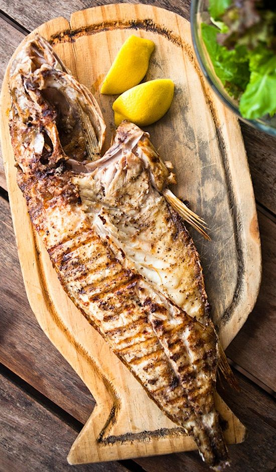 "WHOLE GRILLED CORVINA ~~~ this recipe is shared with us from the beachside cafe restaurant, ""la huella"" in uruguay. [Alejandro Morales] [bonappetit]"