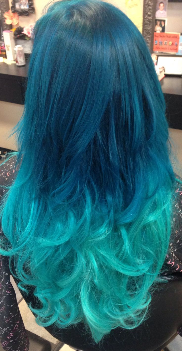 Turquoise pastel ombré hair with extensions added in for length and thickness. Used Schwarzkopf Professional Igora bleach to prelighten, turquoise was achieved with Jerome Russell Punky Color custom mixture. Done by Dacia Metsker at Shag Me Salon in Las Vegas, NV 702-823-5446
