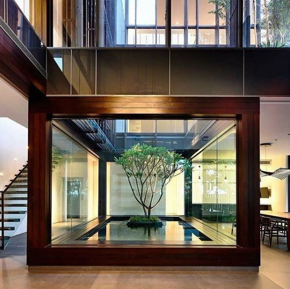 Who wants this in the middle of their house? We do! Stunning atrium.