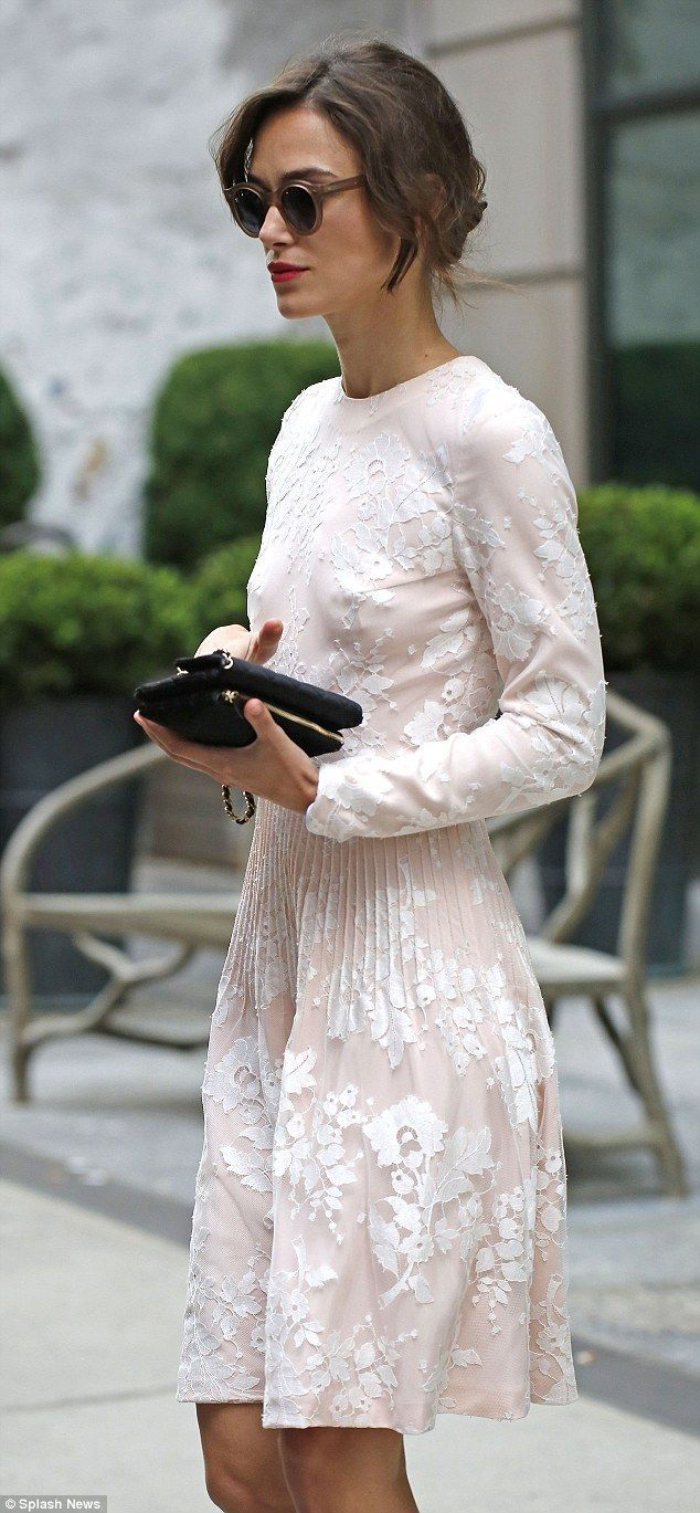 She is keira knightley with a short white dress with long sleeves. This dress is perfect for fall. Day event what to wear.
