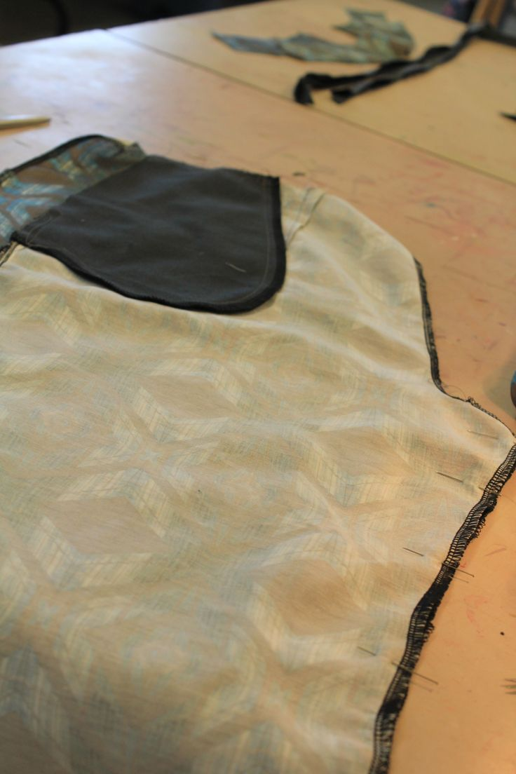 pinning front and back trouser panel together from crotch on the inside of trouser leg.