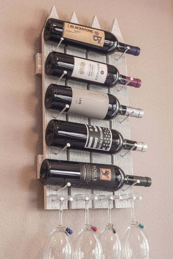 Looking for something unique? This wood wall Wine rack is designed to resemble a picket fence. Its cheery, outdoorsy look comes in a variety of