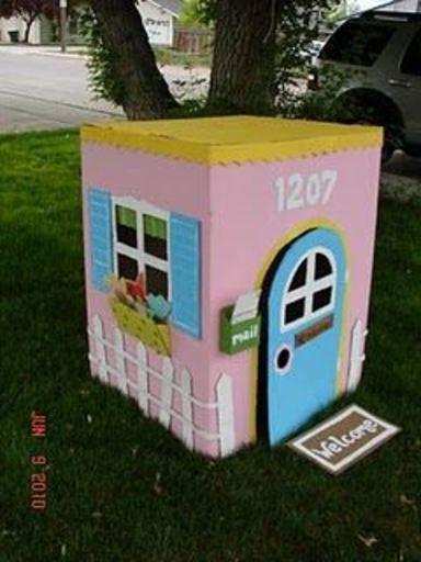 cardboard playhouse - A girl and a glue gun