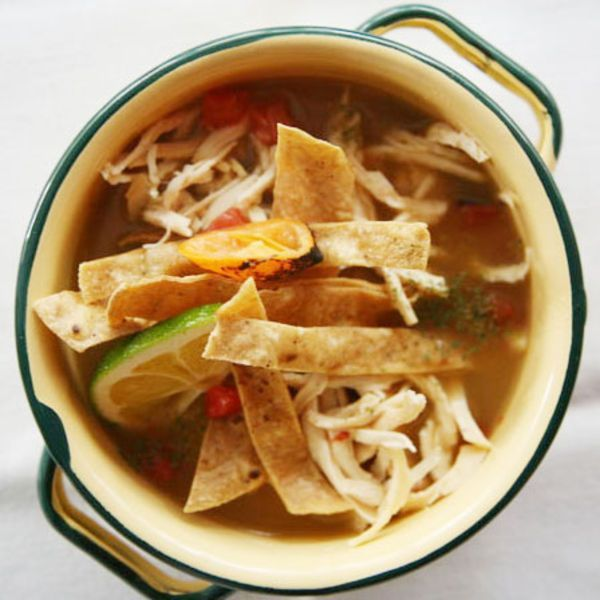Similar to tortilla soup, this version is sour from lots of whole limes in the broth and garnish; roasted habanero chiles add a smoky heat.