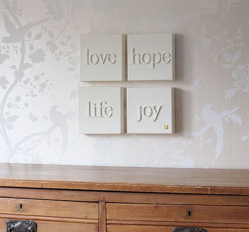 wooden letters on canvas