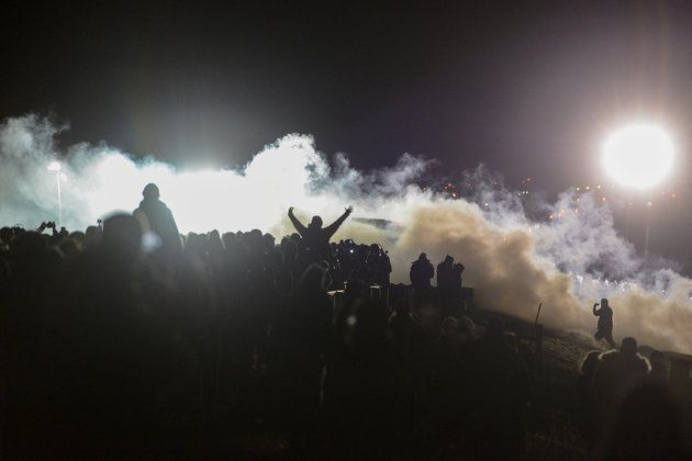 """Woman's Arm May Be Amputated After Horrific Injury At Standing Rock Protests. Wilansky was one of at least 300 people injured Sunday night and early Monday morning, Medic & Healer Council coordinator Michael Knudsen told HuffPost. He said 26 people went to the emergency room with """"blunt trauma and open wounds,"""" mostly from rubber bullets being fired at close range or tear gas canisters that law enforcement shot from cannons, he said.