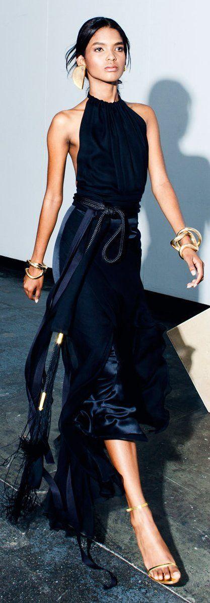 Elegant navy dress with golden oversized accessories