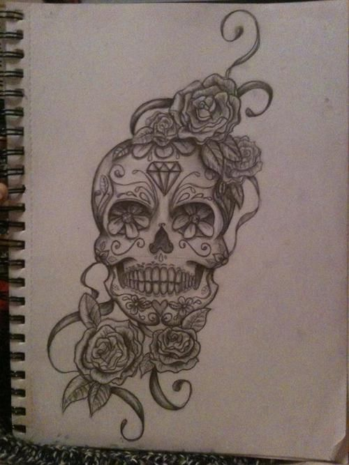 I would totally get this above my ankle or something. sugar skull tattoo with roses