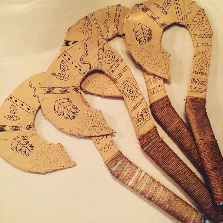 Maui's hook. Cardboard, paper mache, paint, string, sharpie #partyfavor #mauihook
