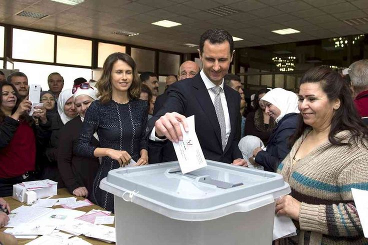 """Share or Comment on: """"SYRIA: Assad Casts Vote In 2016 Parliamentary Elections"""" - http://www.politicoscope.com/wp-content/uploads/2016/04/Bashar-Assad-casts-his-vote-next-to-his-wife-Asma-centre-left-inside-a-polling-station-during-parliamentary-elections-in-Damascus-Syria.jpg - Popular Front for Change and Liberation, another opposition group, also said that it will boycott the elections.  on Politicoscope: Politics - http://www.politicoscope.com/2016/04/13/syria-assad-casts-"""
