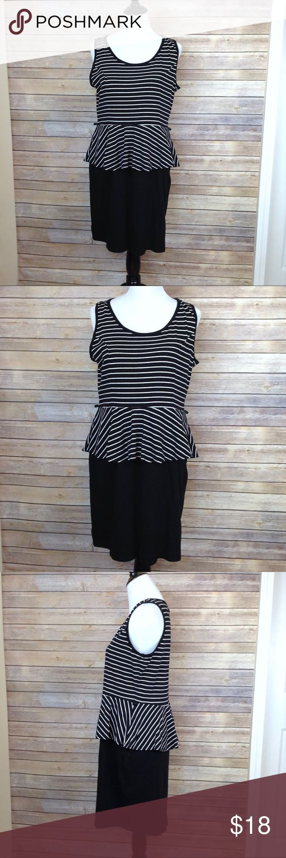 """Derek Heart black & white peplum dress This sleeveless dress is preloved, only flaw is that it has belt loops but no belt, which can easily be snipped off. The fabric is cottony soft.  My mannequin measures 34/28/36 APPROX FLAT MEASUREMENTS  36"""" ↕️ 21"""" ↔️ armpits  CB13 #plussize #peplum #sleeveless Derek Heart Dresses Midi"""