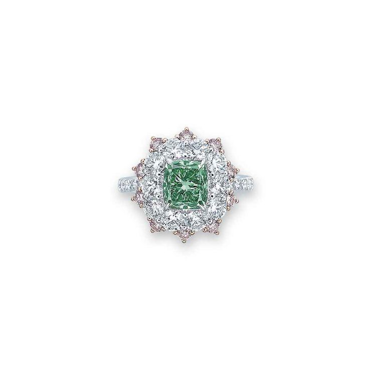 Set with a cushion-shaped fancy vivid bluish green diamond, weighing approximately 2.08 carats, within a circular-cut diamond and pink diamond surround, extending to the gallery and half-hoop, mounted in gold, ring size 6 Accompanied by report no. 11598722 dated 20 July 2001 from the GIA Gemological Institute of America stating that the diamond is fancy vivid bluish green colour,VS1 clarity; also accompanied by a letter stating that the diamond is the largest Fancy Vivid Bluish Green…