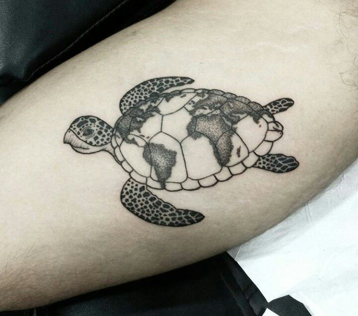 World map on a sea turtle's shell tattoo
