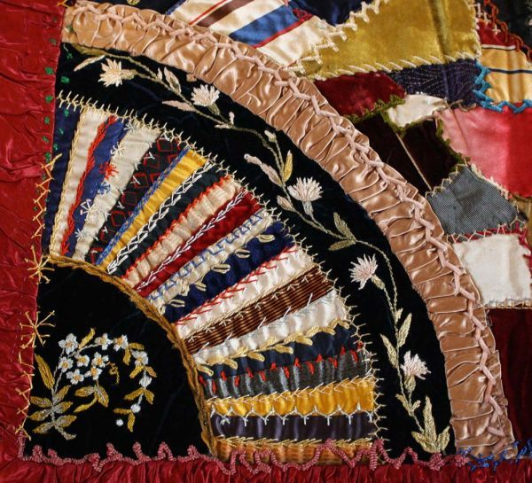 "Detail of a crazy quilt pillow sham.  One wishing ""A Merry Christmas"" and the other ""A Happy New Year"" from 1885-1886.  Glengarry Pioneer Museum."