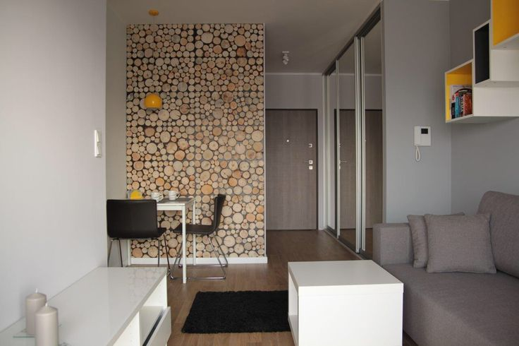 Ikea - Bernhard chairs, Melltorp table, Tutemo open cabinet. Wood slices wall decoration.