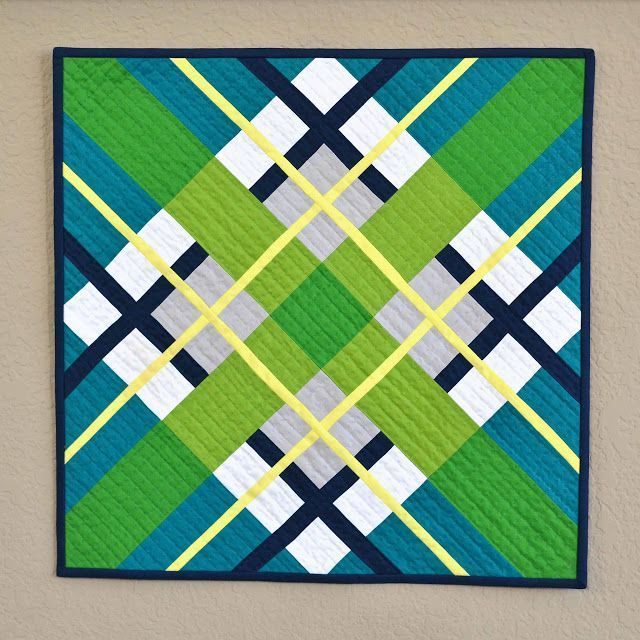 Kona Highlight plaid mini quilt on http://KitchenTableQuilting.com