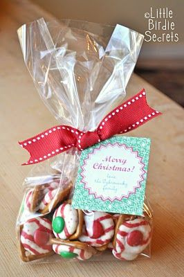 Christmas Pretzel Kisses! {last mintute christmas treats} These little treats are simple to make a huge hit at Christmas!  Holiday Pretzel Kiss Candies Recipe  Ingredients:  *Small, waffle-shaped pretzels  *Hershey's Kisses (plain old chocolate are good, but my favorite are the Candy Cane Kisses--any variety of Kisses or Hugs will work)  *Red & green M's  *Cookie sheet and parchment paper