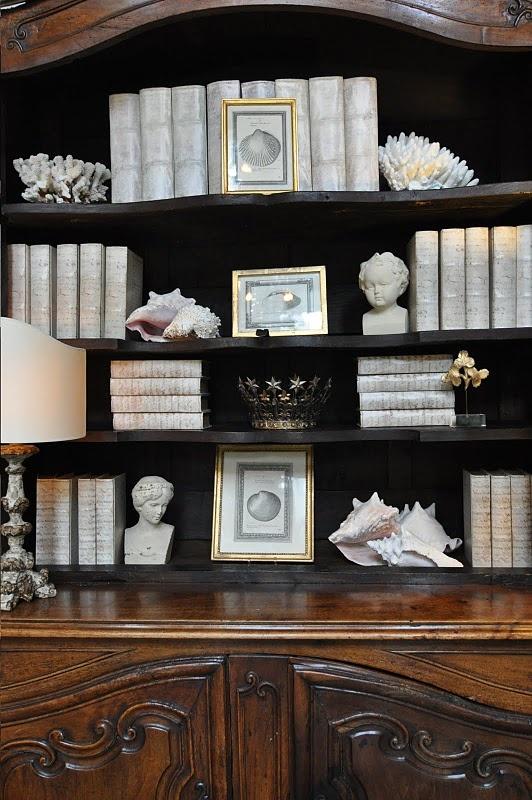 Bookcase, shells, vignette via Cote De Texas Blog