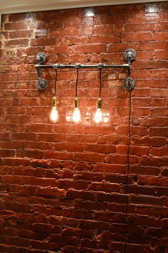Back it w/ barnwood....Hey, I found this really awesome Etsy listing at https://www.etsy.com/listing/160729363/industrial-wall-light