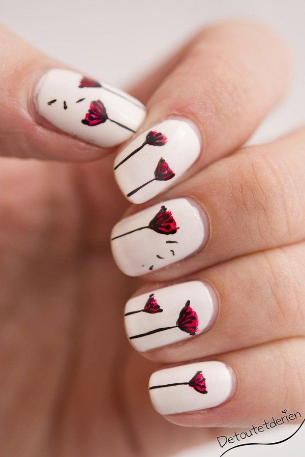 Simplicity is art. Use a matte white background for this interesting design which uses black nail polish for the stems and petals of the Dandelion whilst painting red on top of the flowers giving out a an eye catching color effect.