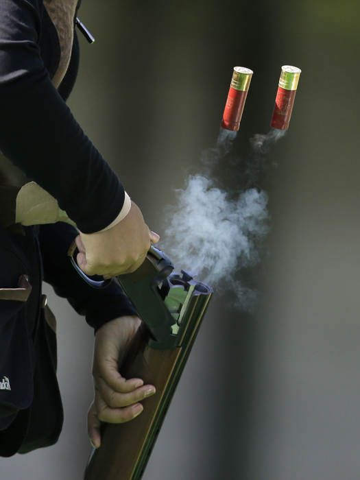 South Korea's Lee Bo-na ejects empty cartridges during the women's double trap shooting competition at the 17th Asian Games at Gyeonggido Shooting Range in Incheon, South Korea, Thursday, Sept. 25, 2014. (AP Photo/Dita Alangkara)