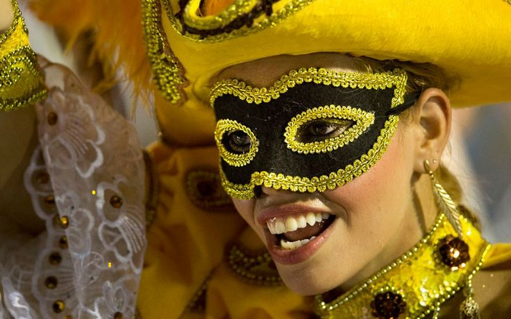 A performer from the Academicos do Salgueiro samba school parades during carnival celebrations at the Sambadrome