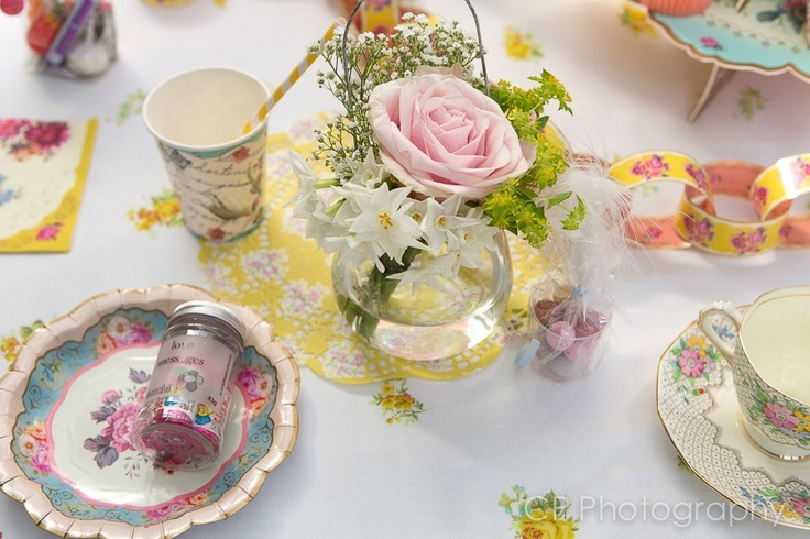 Vintage table ware by www.fuschiadesigns.co.uk, cups, straws, vintage printed plates, dollies, paper chains nd favours.