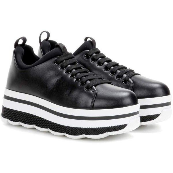 Prada Leather Platform Sneakers ($810) ❤ liked on Polyvore featuring shoes, sneakers, black, black shoes, black leather trainers, black trainers, leather sneakers and leather shoes