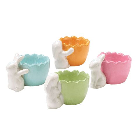 Four cups, each in a different colour and bunny design. Each, 6 cm H x 5 cm diam. Ceramic. Hand wash.  Comes empty.