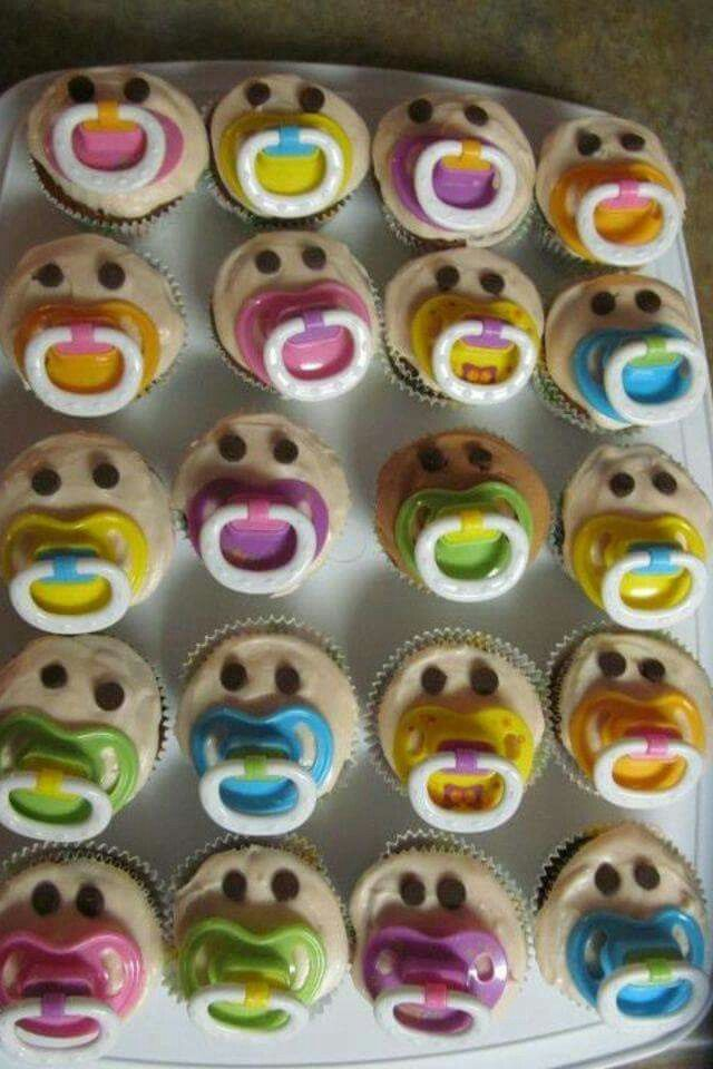 Super cute idea for a baby shower, cupcakes with pacifier's and chocolate chips upside down as eyes.