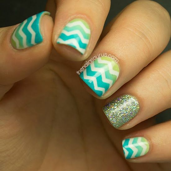 Nails so easily done! Paint your nails white then put a thin piece if tape over I in a design you want. Overlap colors on a foam sponge applicator and apply it to the nail. Take the tape off and you have a super cute nail look!