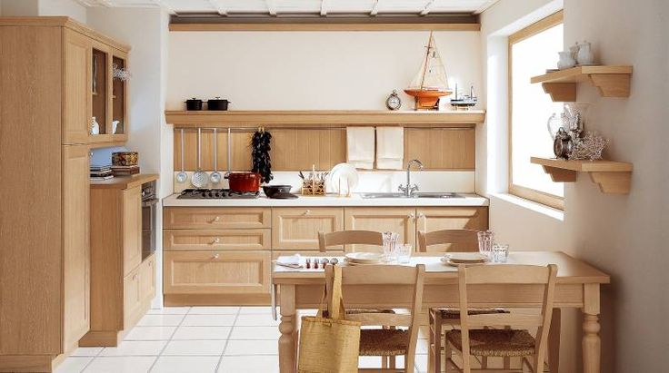 NEWPORT Newport porta in cucina lo stile di un passato in cui la casa godeva di una dimensione di particolare vicinanza con la natura. Il pomolo o la maniglia in metallo lucido permettono di personalizzare a piacere il proprio ambiente.