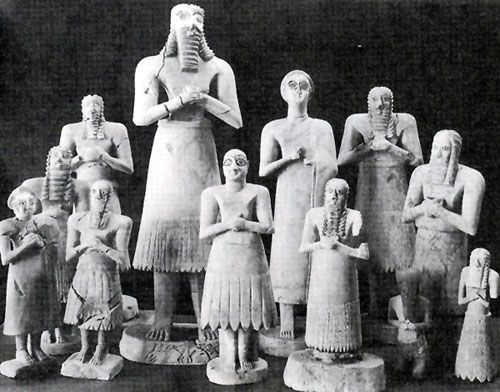 Early Dynastic Period (c. 2900 - 2350 BCE), Mesopotamia: Sumerian Votive Statues. It is believed they were placed in their places of worship to symbolically pray day and night.  Note the stylized beards and hair, large eyes, and attitude of submission embodying the essence of a worshipper. These have been found buried in groups under temple floors and other areas.