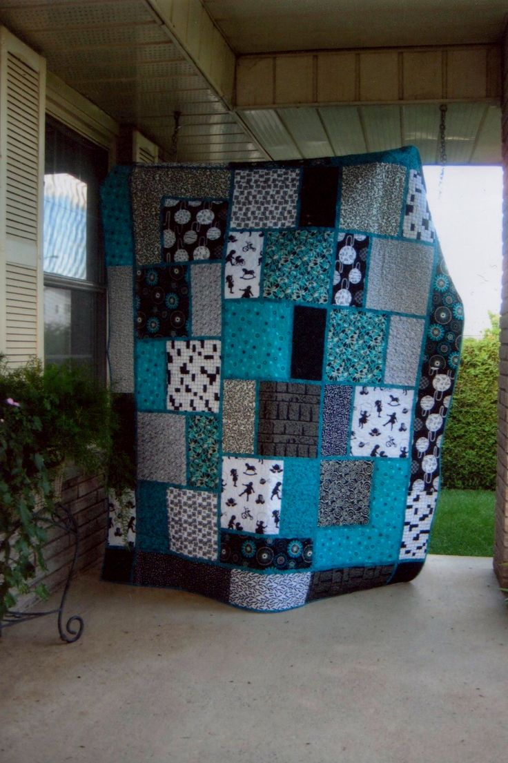 black white and teal quilt, pattern called Big Block Quilt from Black Cat Creations Modified to add another section.                                                                                                                                                      More